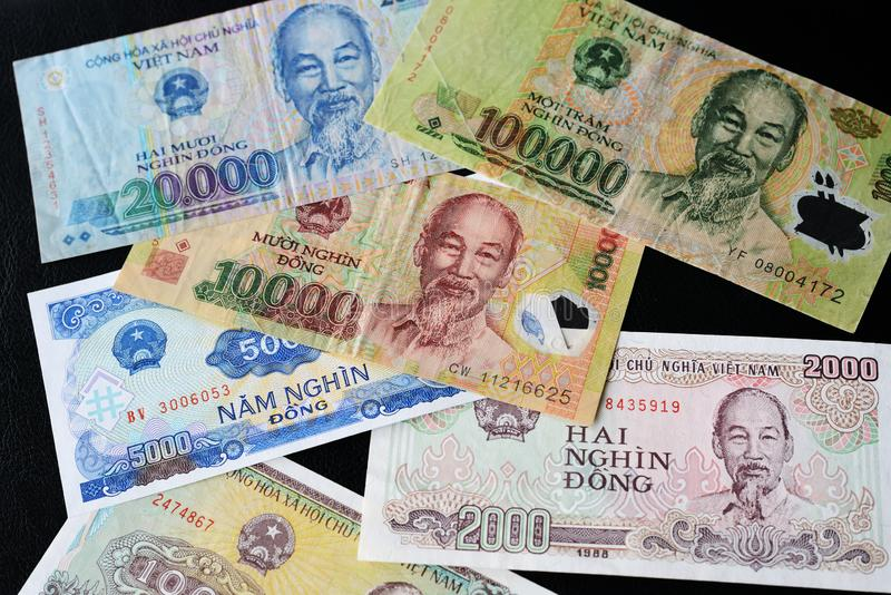 Vietnamese dong bills on a dark background. Money background. Vietnamese dong bills on a dark background close up. Money background royalty free stock photography