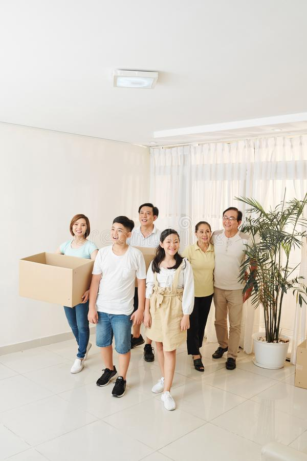 Vietnamese family entering new apartment royalty free stock photo
