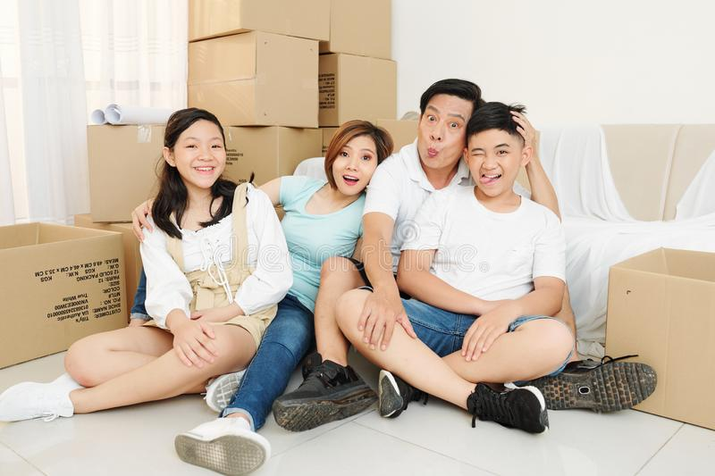 Fanny family in new apartment stock photos