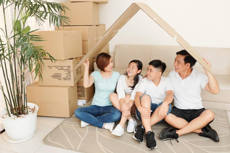Vietnamese family under cardboard roof royalty free stock images