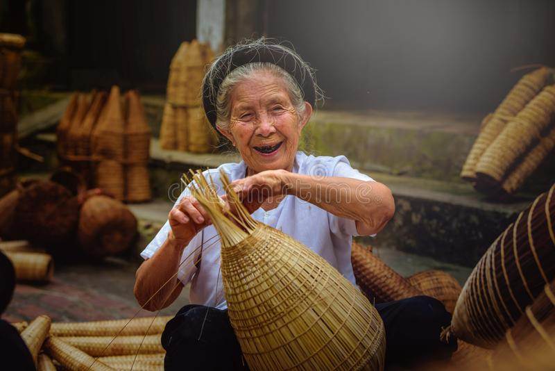 Vietnamese fishermen are doing basketry for fishing equipment at. Morning in Thu Sy Village, Vietnam royalty free stock photography