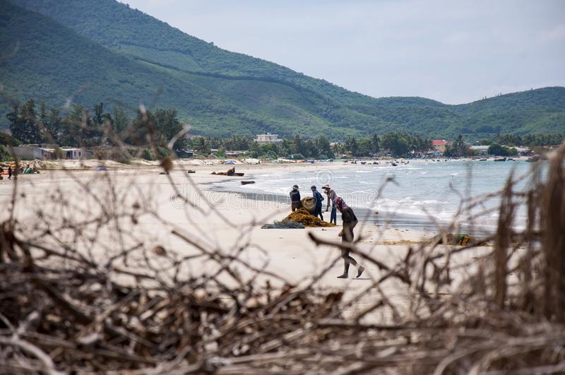 Vietnamese fishermen, sailed to shore with a catch royalty free stock images