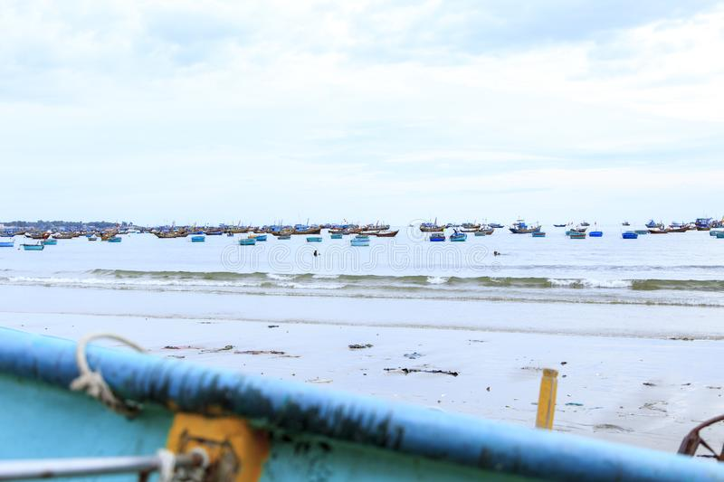 Vietnamese fishing village, Vietnam, Southeast Asia. Landscape with sea and traditional colorful fishing boats royalty free stock photo