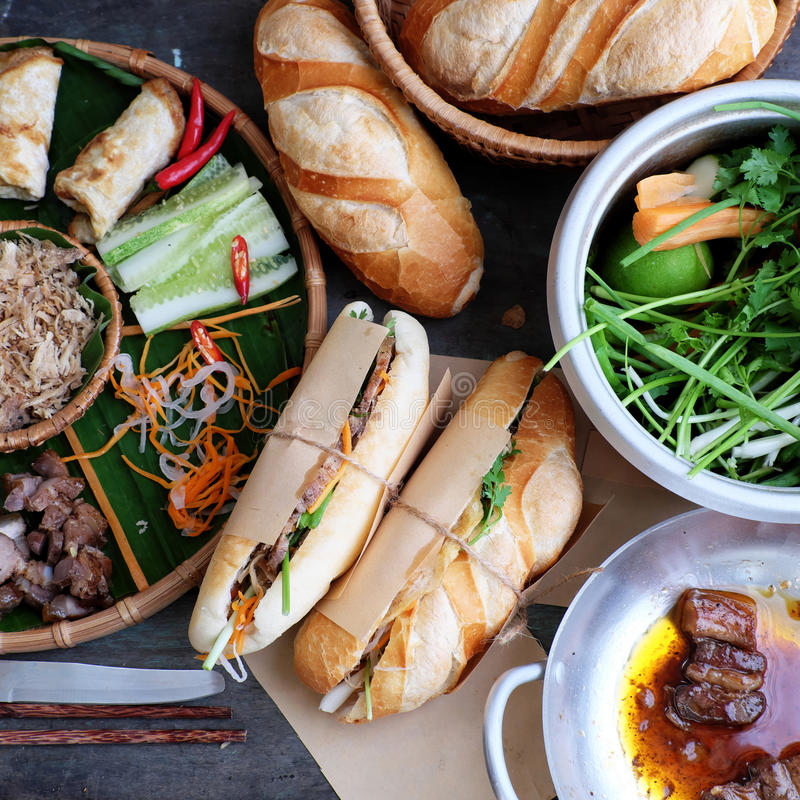 Vietnamese food, banh mi thit. Famous Vietnamese food is banh mi thit, popular street food from bread stuffed with raw material: pork, ham, pate, egg and fresh stock photo