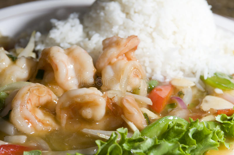 Vietnamese food prawn sauteed. Vietnamese food tom xao gung prawn shrimps sauteed in ginger honey sauce with bell pepper and onion with rice stock photo