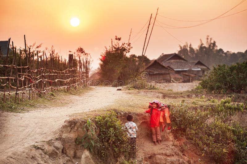 Vietnamese girls and boy playing on the dry canal at sunset royalty free stock image