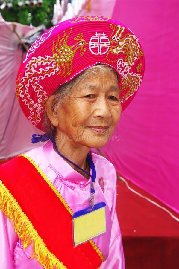 Vietnamese Grandmother In Ao Dai Stock Photos