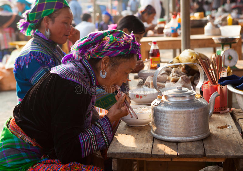 Vietnamese Hmong tribe having meal as breakfast royalty free stock image