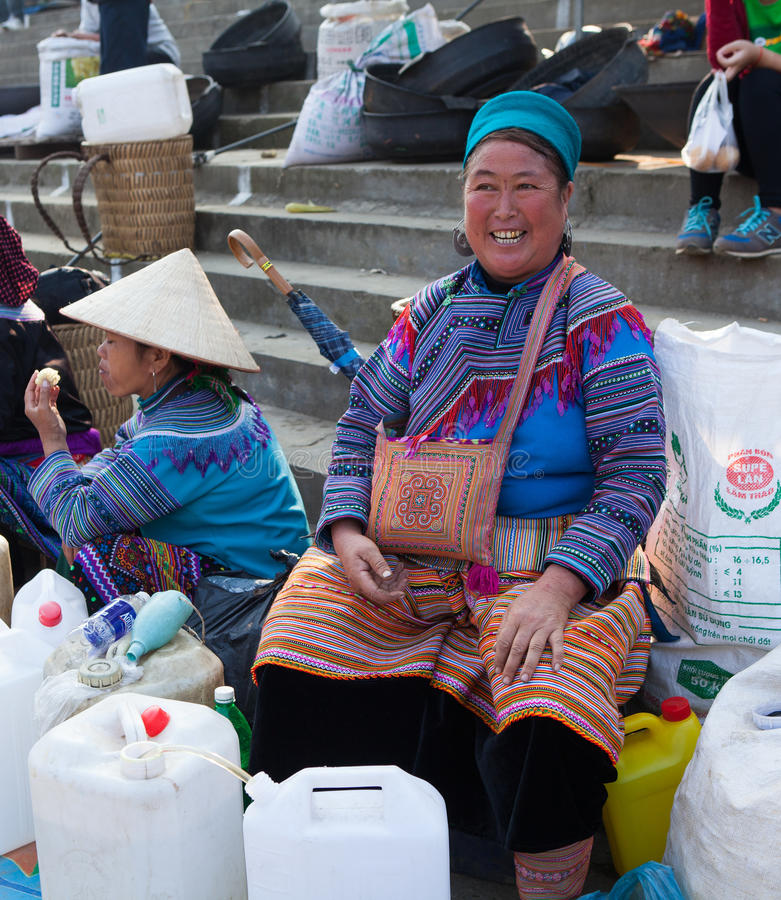 Vietnamese Hmong women selling traditional wine in canes royalty free stock images