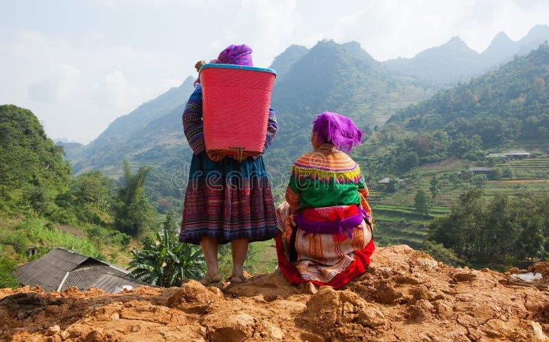Vietnamese Hmong women standing on the side of a mountain pass stock photos