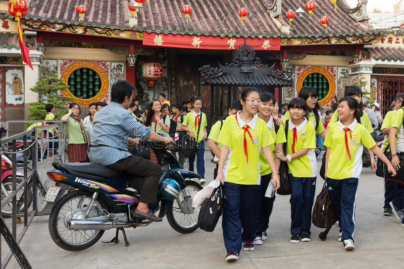 Vietnamese kids leaving class stock photo
