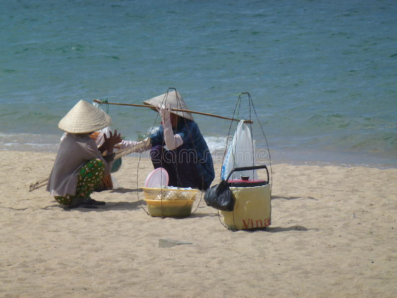 Vietnamese ladies at the beach royalty free stock photography