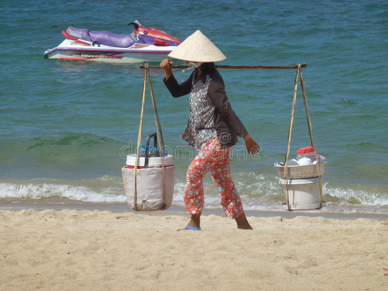 Vietnamese lady walking the beach royalty free stock image