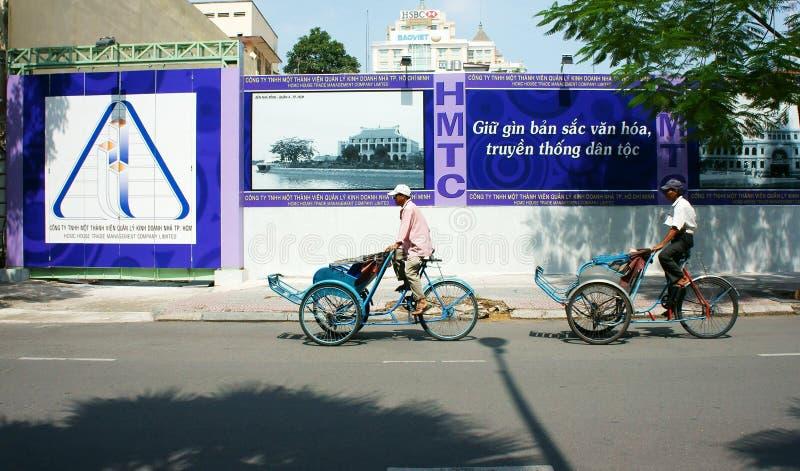 Vietnamese man, cyclo driver. HO CHI MINH CITY, VIET NAM- NOV 17: Asian man on pedicab at Saigon street, Vietnamese male earn money by cyclo driver, a work hard stock photography
