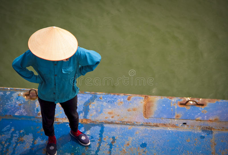Vietnamese man on deck of barge royalty free stock image