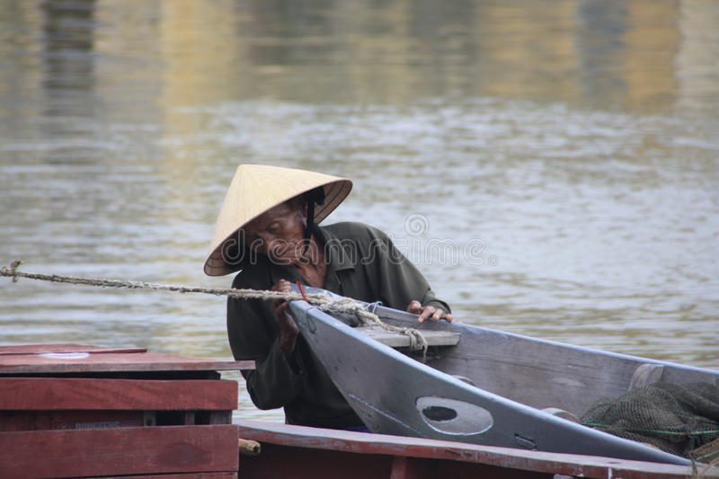 Download Vietnamese Man With Traditional Boat Editorial Photography - Image: 15480287