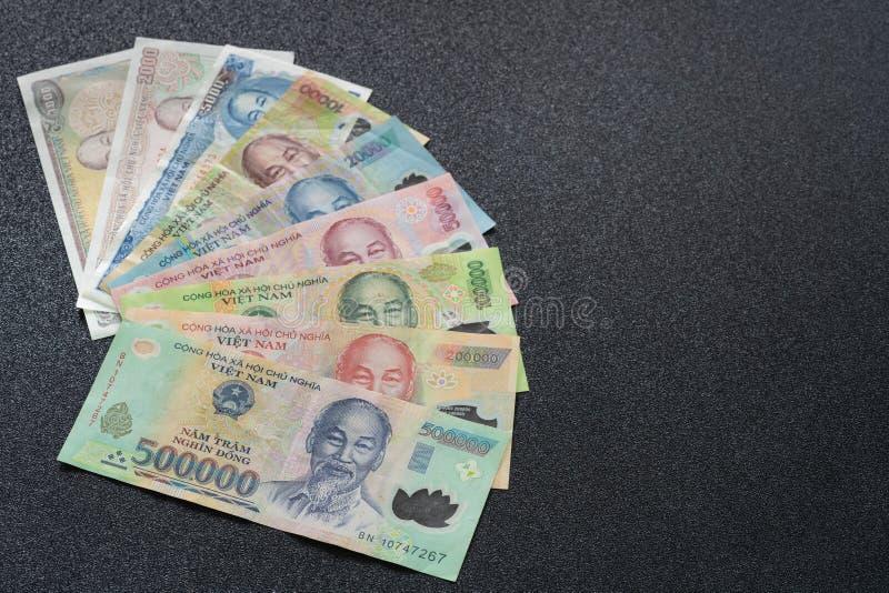 Vietnamese money bill on dark texture - Vietnam Dong VND royalty free stock image