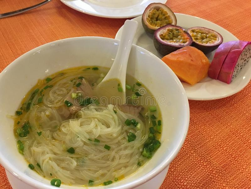Vietnamese noodle soup, sprinkled with herb royalty free stock images
