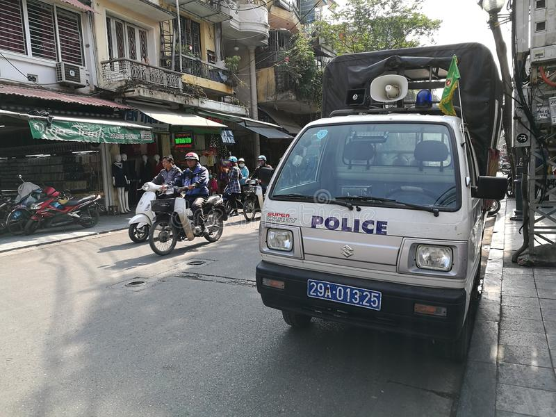 Vietnamese police security officer truck. Hanoi, Vietnam - Dec 17, 2016: Vietnamese police security officer truck parking on the side of an old Hanoi quarter royalty free stock photography