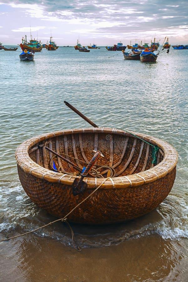 Vietnamese round boat beach sunset stock image image for Round fishing boat