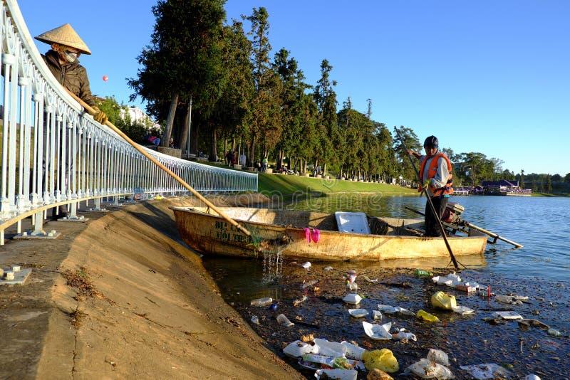 Vietnamese sanitation worker, rubbish, water, pollution royalty free stock photos