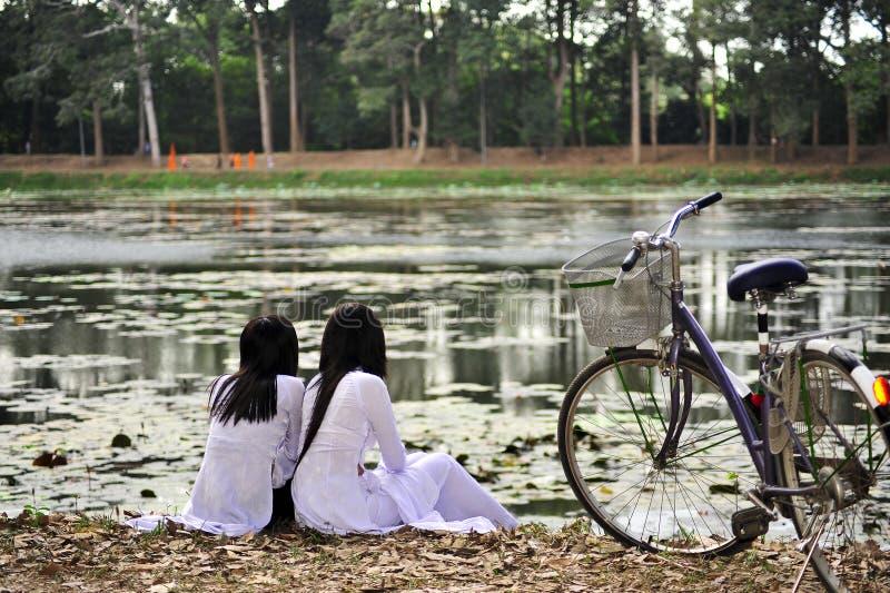 Vietnamese school girls. In tradtional long dress in mekong delta - vietnam stock photos