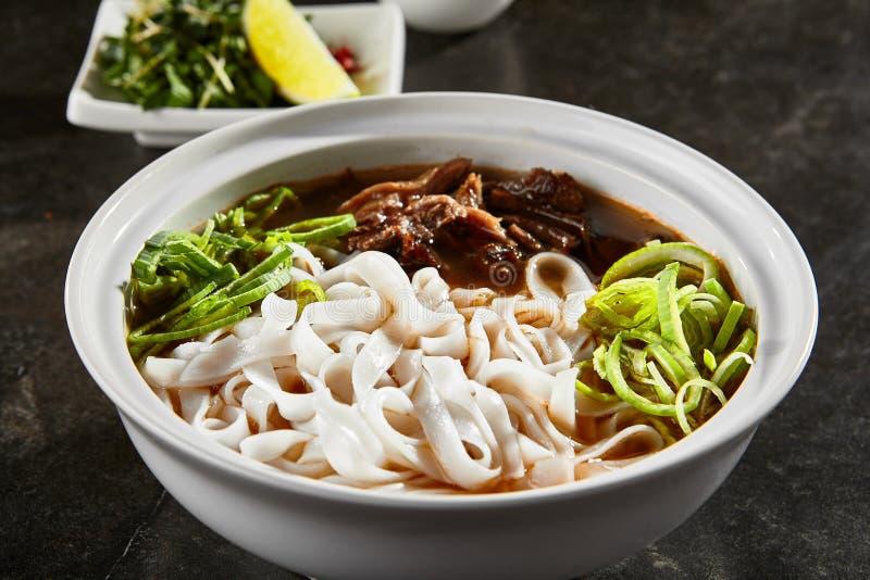 Vietnamese soup pho bo closeup stock images