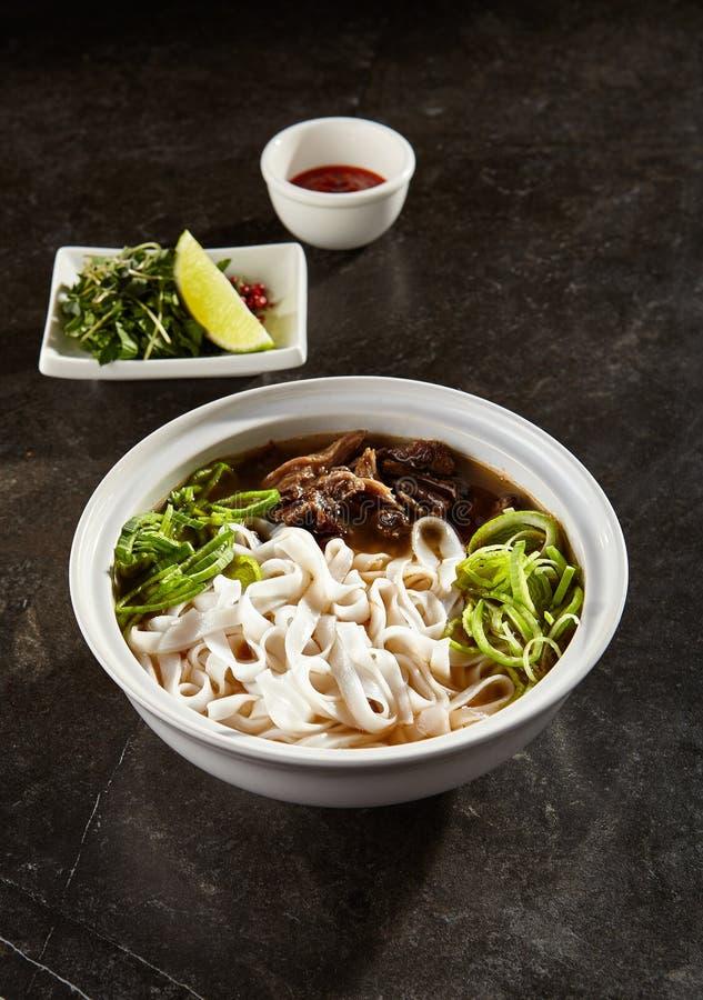 Vietnamese soup pho bo closeup stock photography