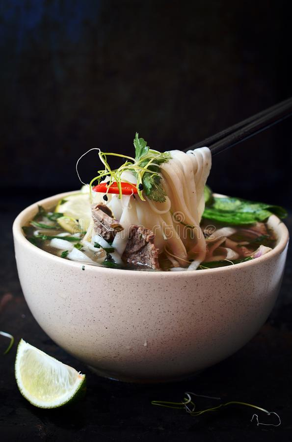 Vietnamese soup Pho Bo with vegetables and rice noodles in a bowl royalty free stock images
