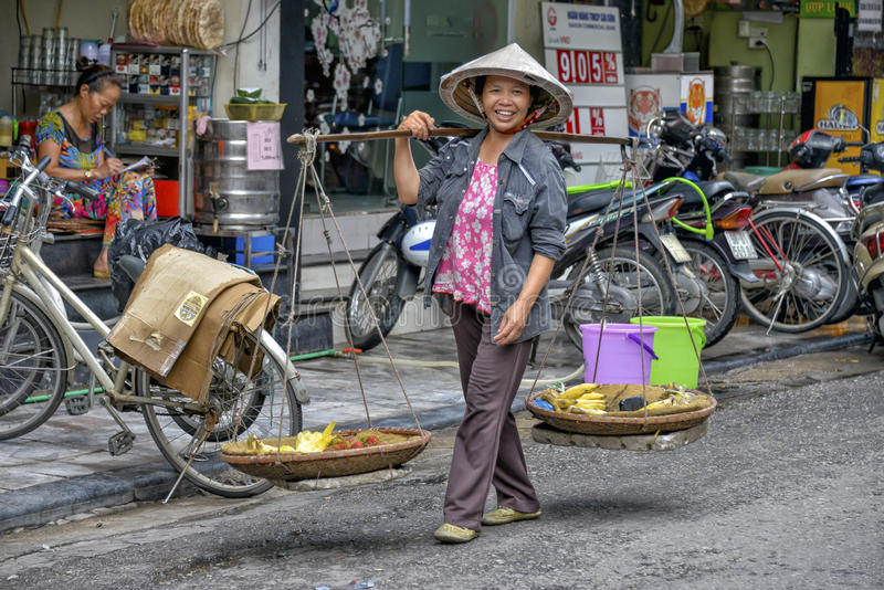 Vietnamese street vendor in Hanoi stock photography