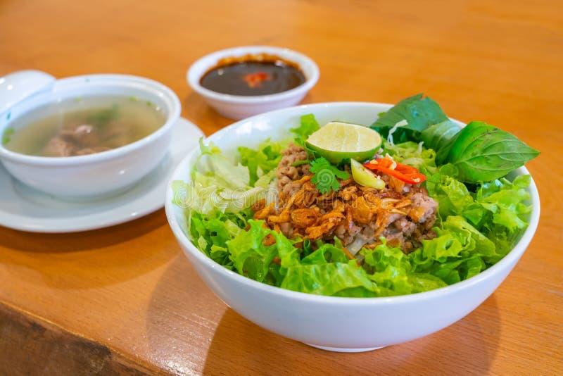 Vietnamese traditional cuisine pork noodle soup with vegetables and herbs. Vietnamese traditional recipe pork noodle soup with vegetables and herbs stock photos