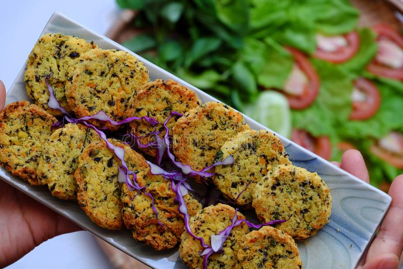 Vietnamese vegan food, green bean pies on salad, savory dish for vegetarian stock images