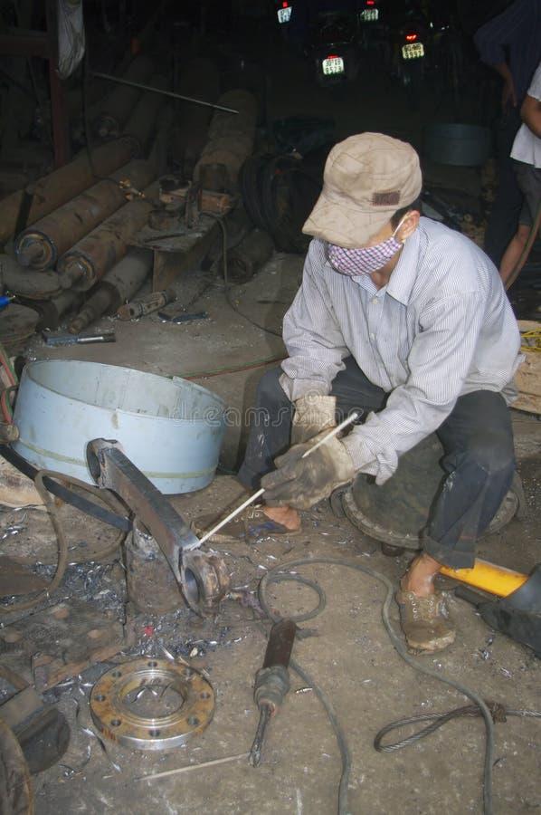 Vietnamese welder on the sidewalk