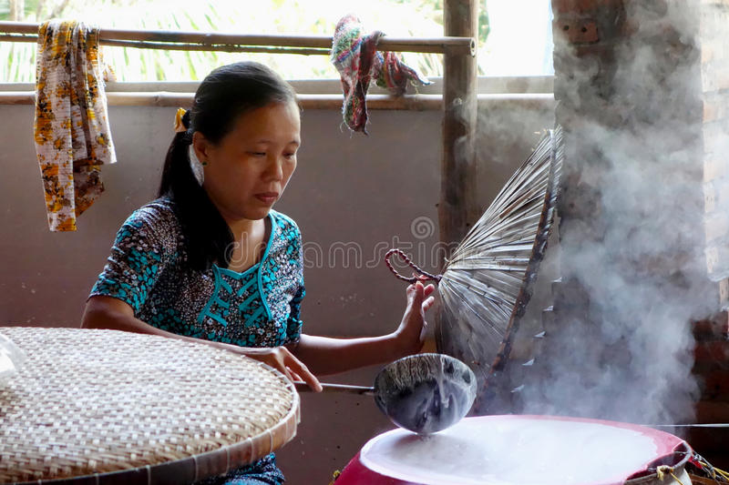 Vietnamese woman cooking stock images