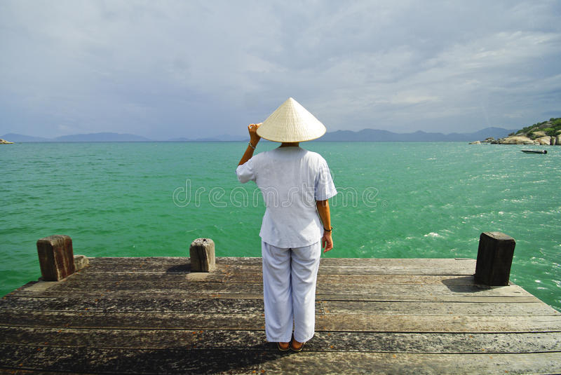Vietnamese Woman in front of the sea stock photography