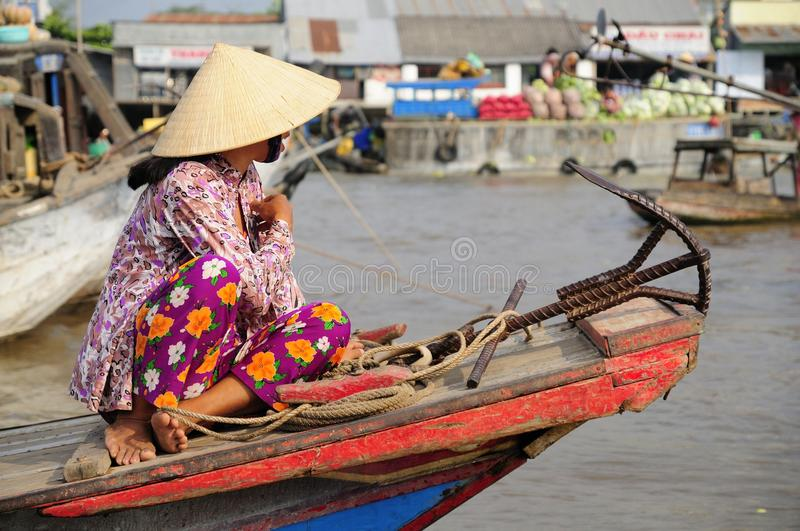 Vietnamese Woman at a Morning Floating Market stock image