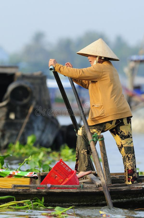 Vietnamese Woman Rowing Boat royalty free stock photo