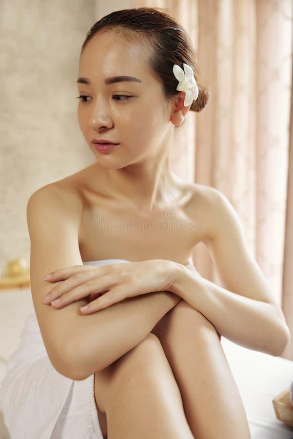 Vietnamese woman visiting spa salon stock images