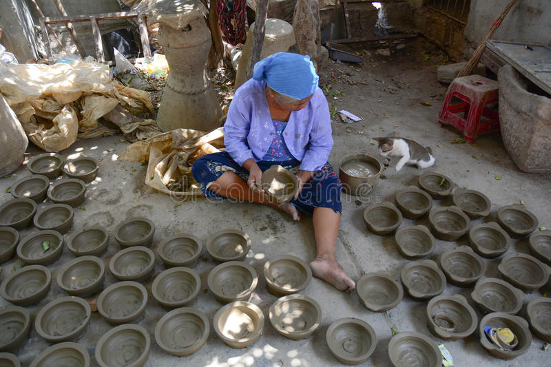 Vietnamese woman worker making potteries royalty free stock photos