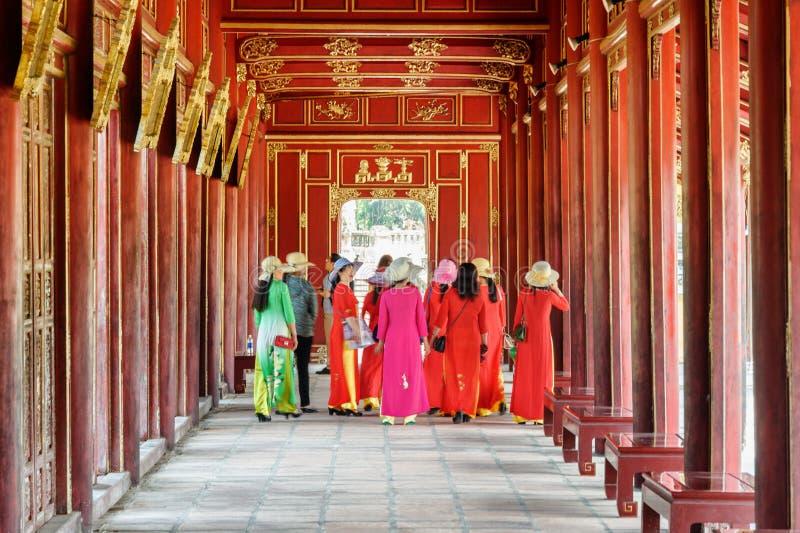 Vietnamese women in beautiful traditional garments Ao dai, Hue royalty free stock image