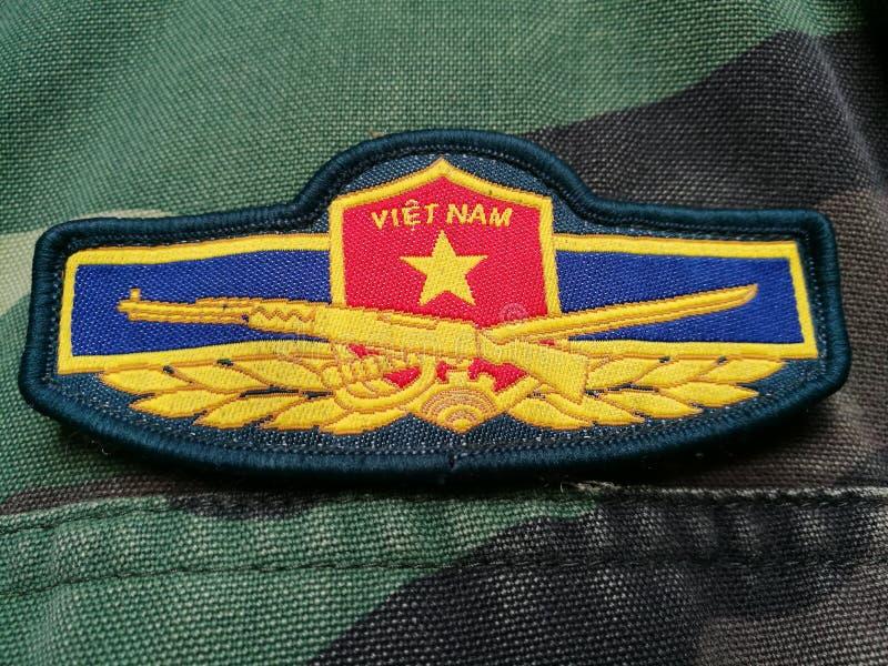 Vietnamesisk armélapp på solder& x27; s-likformig royaltyfria foton
