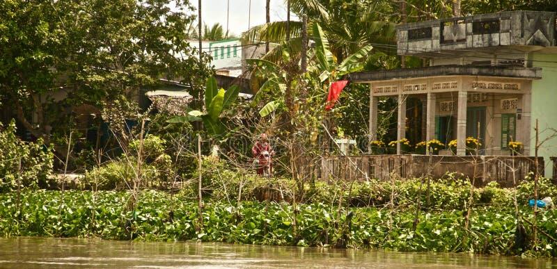 Vietnamesiskt hus i den Mekong deltan, Vietnam fotografering för bildbyråer