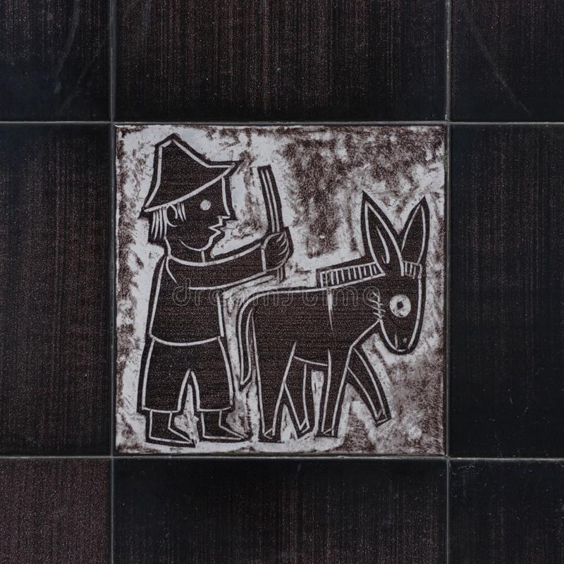 VIETRI SUL MARE, ITALY - 12 October 2019 Representation of a farmer with a donkey on a ceramic tile, the Amalfi Coast. Italy. To mean a concept, animal, art royalty free stock photos