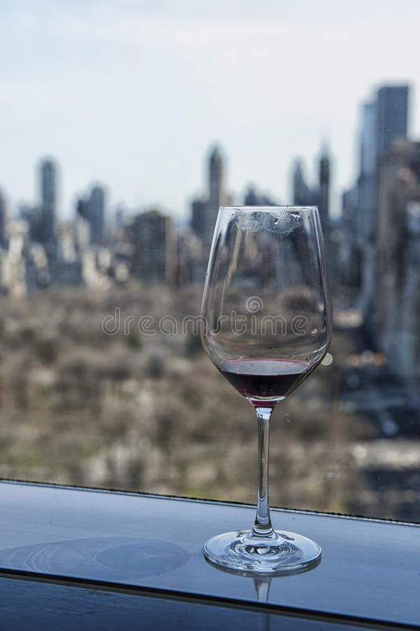 Vieuw over New York Central Park Glass of wine moment. Skyline vieuw from central park New York with a glass of wine from restaurant The Asiate insight the stock images