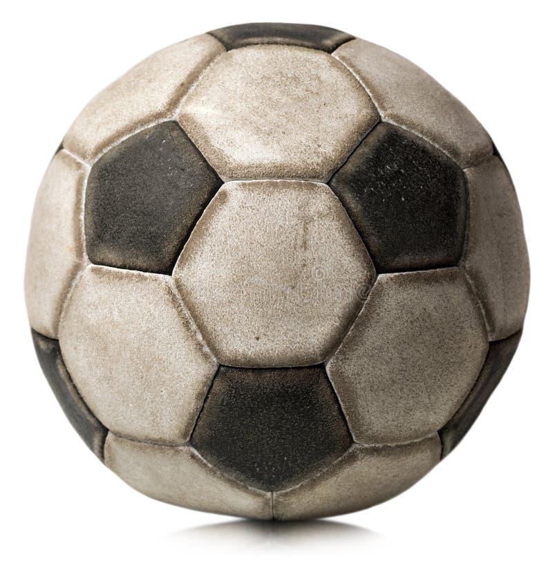 Vieux ballon de football d'isolement sur le blanc images stock