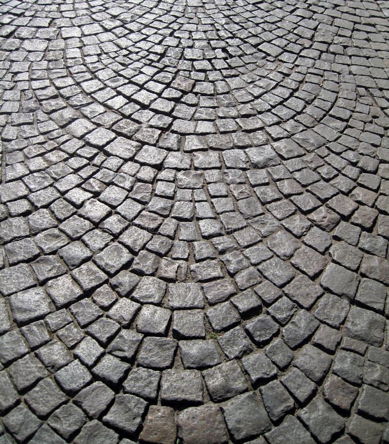 Vieux bloc en pierre pavant le fond image stock