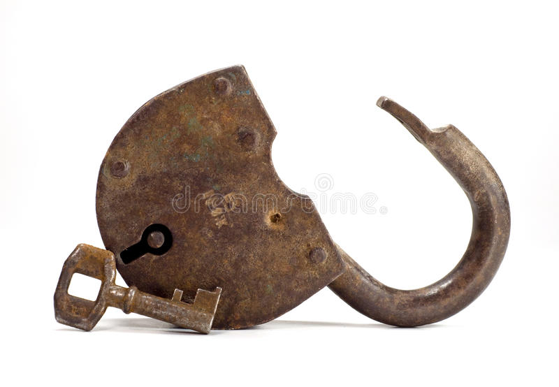Vieux blocage avec la clé photographie stock libre de droits