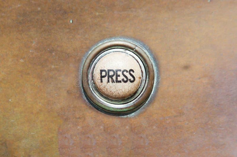 Vieux bouton - presse images stock