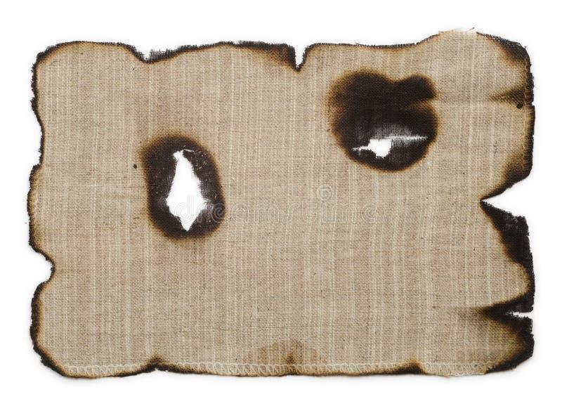 Vieux, brûlé sur les bords du tissu image libre de droits