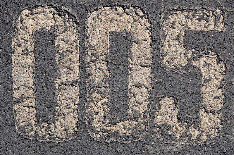 Vieux chiffres d'inscription sur le trottoir images stock